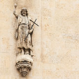 Statue of a saint above portal of gothic cathedral Stock Images
