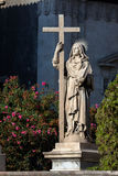 Statue of Saint Agatha holding a book and a cross Stock Images