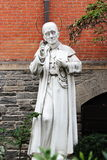 Statue of Saint Alphonsus outside the church of St Anthony of Padua. New York, USA - September 27, 2016: Statue of Saint Alphonsus outside the church of St Royalty Free Stock Photo