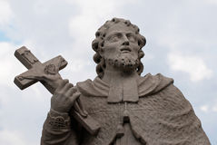 Statue of saint with cross Royalty Free Stock Images