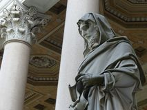 Statue of a Saint in front of the basilica of Saint Paul outside the walls in Rome, Italy. royalty free stock image