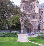 Statue of Saint Jean-Paul II on Notre Dame grounds, Paris. Paris, France, August 29, 2015: Statue of Saint Jean - Paul II is a tourist attraction on grounds of Stock Images