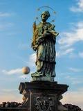 Statue of Saint John of Nepomuk holding Christ on cross, Charles Bridge Royalty Free Stock Images