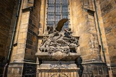 Statue of Saint John of Nepomuk at St. Vitus Cathedral in Prague. Lying in the arms of an angel in a sunny day stock photography