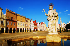 Statue of Saint Margaret. The statue of Saint Margaret, with a row of Renaissance houses in the background, Telc, South Moravia, The Czech Republic Stock Image