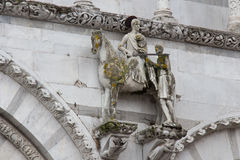 The statue of Saint Martin on the wall of Lucca Cathedral. Cattedrale di San Martino. Tuscany. Italy. Stock Photos