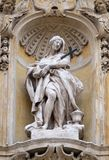 Saint Mary Magdalene. Statue of Saint Mary Magdalene on facade of Santa Maria Maddalena Church in Rome, Italy stock images