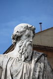 Statue of Saint Paul the Apostle. With the chimney of Sistina Chapel on the background. Vatican City State Stock Photo