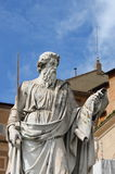 Statue of Saint Paul the Apostle. With the chimney of Sistina Chapel on the background. Vatican City State Royalty Free Stock Image