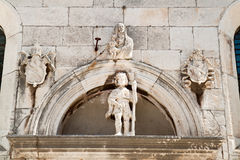 Statue of  the saint placed over the entrance to the old church in Korcula Royalty Free Stock Photography