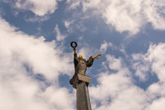 Statue of Saint Sofia. In Sofia city center, Bulgaria, with outstretched arms and a blue cloudy sky in the background Stock Photos