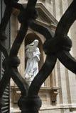 Statue of Saint Teresa of Avila Viewed Through Fen Royalty Free Stock Photo