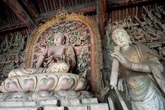 Statue of Sakyamuni buddha and female bodhisattva Stock Image
