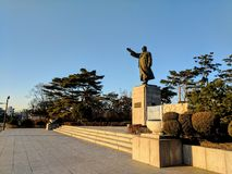 Statue Salute. Statue of man saluting the sun in Seoul, South Korea Royalty Free Stock Photo