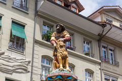 Statue of the Samson Fountain in Bern, Switzerland. Slaying the lion, 16th century traditional colourful fountains & statues in the old city of Bern, Switzerland royalty free stock photo