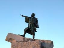 Statue of a Samurai warrior. Statue of Okinawan samurai warrior points out to the ocean Stock Photos