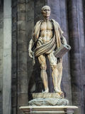 Statue of san Bartolomeo in the duomo of Milan Stock Photos