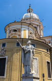 Statue of San Carlo and the Basilica in Rome, Italy Stock Photography