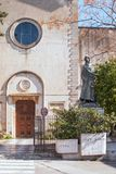 The statue of San Francesco. Standing at the end of the square Gancia in the background is the Church of Santa Maria di Ges stock photo