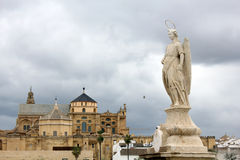 Statue of San Rafael in the Roman bridge Stock Photos