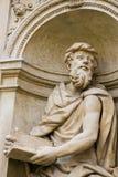 Statue at Prague Loreta. Statue at the Santa Casa of Loreta, a large pilgrimage site in Hradcany, Prague, of a figure holding a Sacred Text Stock Photography
