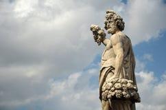 Statue on the Santa Trinita bridge in Florence Royalty Free Stock Image