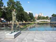 Statue of Satyr on Butcher bridge in Ljubljana, Slovenia. Butcher bridge, Ljubljana, Slovenia-Eastern Europe royalty free stock photo