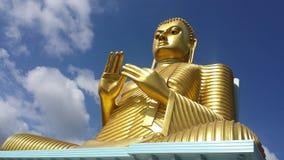 Statue se reposante d'or de Bouddha Photographie stock