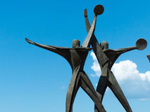 A statue of seamen in taranto, in the south of italy. A statue of seamen saying goodbye on the  taranto seafront, in the south of italy Stock Photos