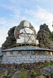 Seated Buddha in Shad Tchup Ling Buddhist monastery on mountain Kachkanar. Russia Royalty Free Stock Photography