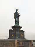 Statue of Sf. John of Nepomuk on Charles bridge in Prague Royalty Free Stock Photo