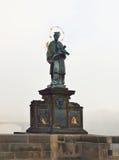 Statue of Sf. John of Nepomuk on Charles bridge in Prague Royalty Free Stock Photo