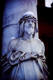 Statue - shallow dof. Statue of jesus christ closed at one column in a cemetery stock photography
