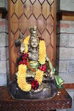 Statue of Shiva. A statue of Shiva adorned with garlands of flowers Stock Photo