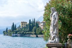 Statue on shore of Lake Como stock photography