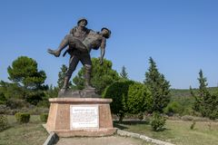 The statue showing Turkish soldier Mehmetcige Saygi Aniti. The statue showing Turkish soldier Mehmetcige Saygi Aniti carrying a wounded Australian officer back royalty free stock image