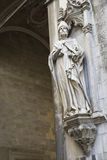 Statue on side of Italian church. Stock Photos