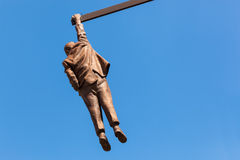 Statue of Sigmund Freud hanging by one hand in Prague, Czech Republic. Stock Photos