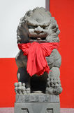 Statue of Singapore. Singapore has a red cloth tied statue sculpture by the Chinese Stock Images