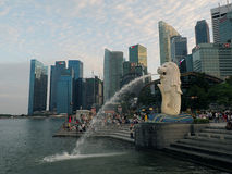 Statue of Singapore. Merlion- statue of a combination of Leo and Pisces, the national symbol of Singapore squirting water at Merlion Park stock photos