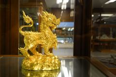 Statue of singha golden. In thailand royalty free stock photo