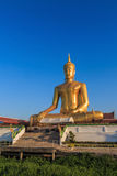 The statue of sitting Buddha in Bangkok Thailand with blue sky Royalty Free Stock Photo
