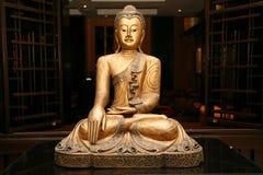 Statue of sitting golden Buddha Royalty Free Stock Image