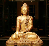 Statue of sitting golden Buuddha Stock Images