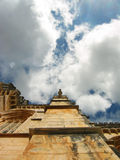 Statue in the sky. A perpective of a church in portugal, with a very high statue Stock Photos