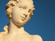 Statue with sky background. Female statue with a blue sky background Royalty Free Stock Photos