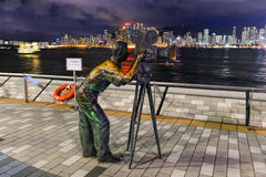 Statue and skyline in Avenue of Stars Stock Photography