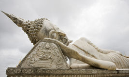 Statue of a sleeping buddha in laos Royalty Free Stock Photography