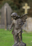 Statue of small child as angel Stock Photos