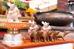The statue of the small white and brown rat on the table in the shrine temple Royalty Free Stock Photos